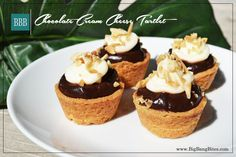 Chocolate Cream Cheese Tartlet | Big Bang Bites | bigbangbites.com | Cups of buttery crust mounded with chocolate pudding, covered with  a rich cream cheese frosting, and sprinkled with almond slivers.