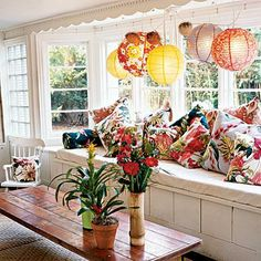 This window seat sings with a bevy of throw pillows with tropical prints. Coastalliving.com