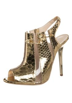 PARTY HEELS! - remember the Liz Hurley safety pin dress? - well, buy the heels to match this year's LBD > Versus Versace