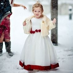 Why We Love It: We love this flower girl's sweet attire for a winter wedding!