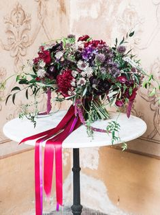 From crimson red flowers to festive greenery, here are 15 options perfect for your winter wedding bouquet.