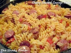 Cheesy Smoked Sausage Pasta by The Shady Porch  Angel Dawn: I have made this.  I modified the steps a little (I put the pasta in after I added the chicken stock, didn't measure the chicken stock just added 3 cans I had in the cabinet, added the butter and let it melt, and used mild shredded cheese, since that was what I already had).  It was PERFECT for a cold, rainy winter day watching football!!!