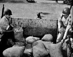 Sacos de arena que protegían al camión