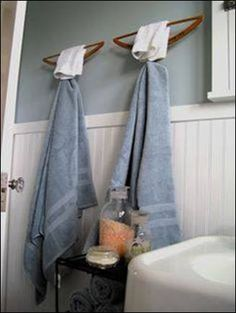 In the upstairs bathroom, I repurposed two old wooden hangers as towel bars. By anchoring a scrap piece of dowel to the wall before the hanger was attached with 2 screws, I created a simple, yet sturdy place to hang a towel! Bathroom Towel Hooks, Bathroom Storage, Bathroom Ideas, Anchor Bathroom, Wooden Bathroom, Kmart Bathroom, Disney Bathroom, 1950s Bathroom, Mermaid Bathroom