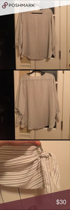 Tie Sleeve Striped Blouse Never Worn! Super cute on-trend tie sleeve blouse. Lightweight material. 3/4 length sleeve. Small stain on inside of Blouse that cannot be seen when worn. Can probably easily be washed out Tops Blouses