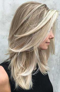 Mittellange Frisuren und Schnitte, die Sie sehen sollten