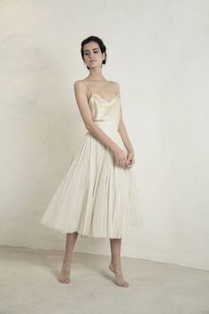 Cortana Wedding Dress. Silk satin champagne colour Rama top with a V neck and fine straps. Worn with Peonia, a 1950's style corseted waist tutu skirt made with various layers of cotton tulle and silk organza. Made in Barcelona. Cortana Bridal Collection 2017. Shop now.