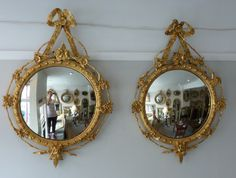 An usual pair of gilt decorated convex mirrors. www.annabellesgiltshop.co.uk