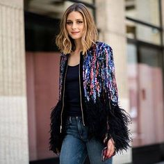 There's a fine line between too much and too simple. OP perfectly pairs simple jeans with a glam sequin statement piece.