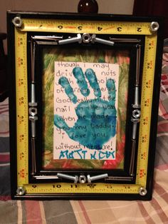 Father's Day Gift! Picture frame, tape measure, nuts, bolts, nails and hot glue. My son painted some card stock and I cut it out for the mat and helped him make a handprint. After it dried, I wrote on it with sharpie, and helped my son sign it. My hubby LOVED it!! :D