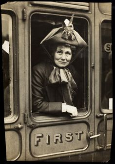 "Emmeline Pankhurst (née Goulden 15.7.1858|14.6.1928) Founder of the Women's Social and Political Union (WSPU), an all-women suffrage advocacy organization dedicated to ""deeds, not words."" Her daughters, Christabel, Sylvia and Adela were also leading members of the WSPU. Adela and Sylvia left the WSPU in 1913. Emmeline is seen here in a First Class carriage leaving Waterloo Station, London, c. 1910."