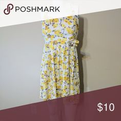 White and yellow spring dress White with yellow flower print halter dress. Above knee length. Size 11 Dresses Strapless
