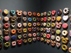 """""""Donut Rush"""" - Jae Yong Kim's ceramic donut installation - Lyons Wier Gallery, New York - Paying tribute to Pop artists present and past with his use of familiar motifs, Kim's sculptures beg the question """"is the viewer visually consuming a donut, an artwork, or the art world at large?"""""""
