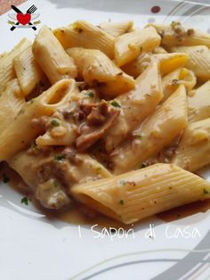 Penne with creamy white sauce with porcini mushrooms