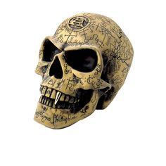 Invite an element of ancient mystique into your home or castle with this life-sized skull. Carved with the symbolic wisdom of the ancients, it's the perfect piece for your Alchemy Goth collection. Even if it doesn't help you solve life's mysteries, the gold colored fang tooth is a really conversation starter! <br>  <ul><li> Unique alchemist skull statue with gold fang tooth </li>  <li> Made from cast resin in an antique finish</li>  <li> Mea...