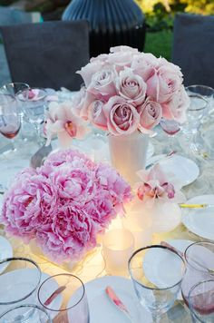 All of the comforts of the indoors were brought outside for this luxurious bridal shower. The pink and gray color scheme was both feminine and sophisticated, with plush carpeting, velvety seating and sleek silver finishes. Ultra-girly florals and ruffled table linens made the event the ultimate girl