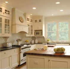 White kitchens with dark surface tops; I love this style but prefer dark floors with it as well.