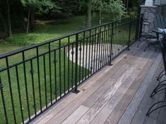 Aluminum Railing on a wood deck - Look at Picture 43 on Hercules website for deck planking idea.
