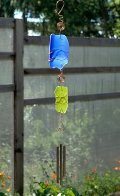 A beautiful glass and copper sun catcher wind chime. Inspired by nature. This suncatcher measures 30 inches long from the top of the handcrafted copper hook to the bottom of the brass chimes. The arti