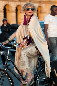 Perfect cycling attire, not! But she looks great so who cares... Catherine Baba in vintage satin