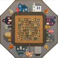 Prairie Town in Autumn Table Topper Pattern by Little House Quilts at KayeWood.com. The centerpiece of this unique table topper is a small, antique reproduction quilt representing a piece of America's quilt history. The prairie town, which is appliqued to the borders around the little quilt, is made from wool and embellished with buttons and embroidery. http://www.kayewood.com/Prairie-Town-in-the-Autumn-Table-Topper-Pattern-by-Little-House-LHQ-PRTOAU.htm $10.00