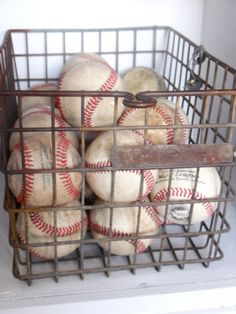 Baseballs in a vintage locker basket…or a wire basket from HomeGoods….maybe… Baseballs in a vintage locker basket…or a wire basket from HomeGoods….maybe a good idea for game ball collection Braxton!