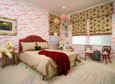 SUZANNE MYERS ELITE INTERIOR DESIGN: A little girl's bedroom with toile wallpaper, hot air balloon fabric on windows and three hanging hot air balloons for a whimsical touch.