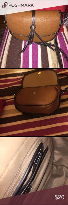 Faux leather saddle bag 😊 London Fog pebbled tan and brown faux leather bag. Barely used. Magnetic front closure. One zip pocket inside with two open pockets for cell phone etc.  Approximately 11 in. across and 8 in. tall. Approximately 20 in. strap drop. Great bag 💼! London Fog Bags Crossbody Bags