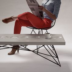 This Concrete Coffee Table Has Built-In Saucers