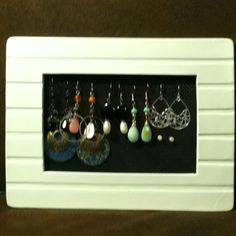 Screen material + glue + spray painted picture frame = earring holder!