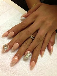 Beige nude glitter nails. Those huge diamonds really ruin the look.