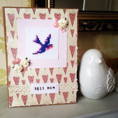 Cross-stitch bird card made using Santoro Mirabelle papers.