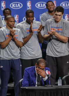 Oklahoma City's Kevin Durant wipes the tears from his eyes as teammates Russell Westbrook, Kendrick Perkins, Steven Adams and the rest of the team applaud during a news conference announcing Durant as the winner of the 2013-14 Kia NBA Basketball Most Value Player Award in Oklahoma City, Okla. on Tuesday, May 6, 2014. Photo by Chris Landsberger, The Oklahoman