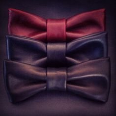 These classic clean leather bow-ties have no date or time frame and can be worn dressed up or down. Available in black, navy or wine.