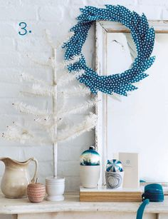 "paper polka dot wreath: scrapbook paper cut into leaf shapes with scalloped scissors, glued onto 10"" wire wreath"