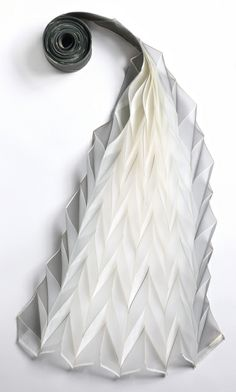Origami Pleat was designed in 1997 by Reiko Sudo (b. 1953), one of Japan's most important contemporary textile designers and co-founder of NUNO. The textile is a contemporary interpretation of centuries-old hand pleating. / http://www.nuno.com/home.html