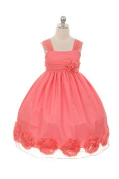 Coral tulle flower girl dress with flower rosettes.