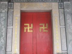 Two swastikas on the door of the Da Fo Temple (大佛寺) in Banqiao ::::♔❥♡ ♤ ♤ ✿⊱╮☼ ☾ PINTEREST.COM christiancross ☀❤ قطـﮧ ⁂ ⦿ ⥾ ⦿ ⁂ ❤U •♥•*⦿[†] ::::