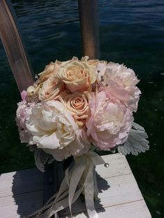 peonies, sahara roses with dusty miller soft and very vintage