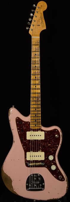 Fender CS Jazzmaster in a very worn Shell Pink.