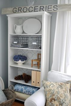can put fabric or wallpaper on the back of shelves.  very pretty and cheap to transform a cheap bookcase.