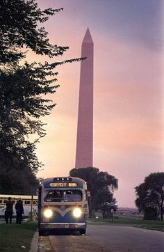 Buses leave in the shadow of the Washington Monument following the March On Washington, 1963.
