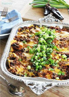 A recipe for easy taco casserole featuring ground beef, beans, tortillas and cheese.