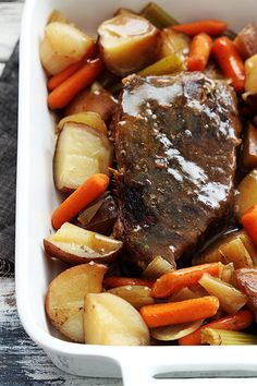 Slow Cooker Beef Roast (cook on low for 9 hr or high for 6 hr - serves 4: 1 3 lb chuck or rump roast, 2 T steak seasoning, 1 T Italian seasoning, 2 C beef broth, 1 lb baby carrots, 2 lb potatoes chopped into 2 inch pieces, 1 large white or yellow onion, 1 stalk celery, salt and pepper, garlic powder, onion powder, and cold water + corn starch)