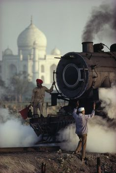 Men working on a steam train, Agra, Uttar Pradesh, India, Steve McCurry. Film Photography, Street Photography, Travel Photography, Better Photography, Creative Photography, Landscape Photography, Nature Photography, Fashion Photography, Wedding Photography