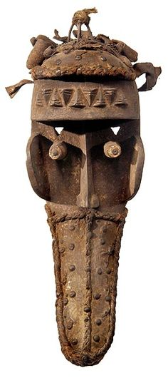 """GREBO Mask 4 52"""" high Grebo masks are characterized by an elongated nose and tubular eyes. Since the masks often have multiple pairs of eyes, they may depict seers."""