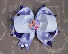 A personal favorite from my Etsy shop https://www.etsy.com/listing/233093210/rapunzel-hairbow-tangled-hairbow-purple