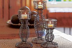 Rustic Wire Elevated Votive Trio.  These wonderful holders take the large tealights that Partylite now makes.  They last up to 14 burning hours.    www.Partylite.Biz/GoldenLites