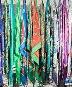 Hermes scarves - all in a row. Fabric Strip Curtains, Fabric Strips, Silk Scarves, Hermes Scarves, Hermes Bags, Fabric Display, Ways To Wear A Scarf, Black Wardrobe, Scarf Design