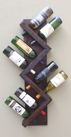Wall Wine Rack 8 Bottle Holder Storage Display by AdliteCreations # diy wine rack easy bottle holders Zig Zag Wine Rack, Rustic Wood Wall Mounted Wine Bottle Display, Wine Bottle Storage Holder, Vertical Wine Rack Diy Simple, Easy Diy, Wine Bottle Display, Wine Bottles, Wood Wine Bottle Holder, Bottle Wall, Wine Decanter, Rustic Wine Racks, Diy Wine Racks